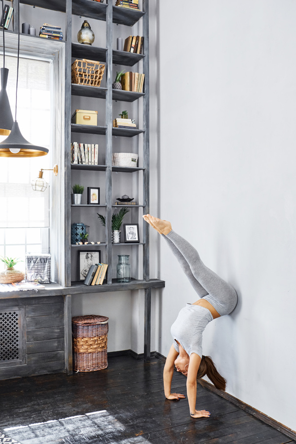 Woman practicing yoga in the living room stock photo 24 for Living room yoga