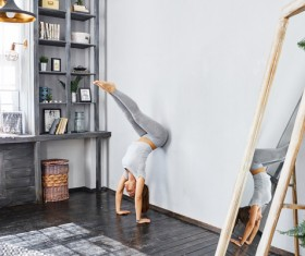 Woman practicing yoga in the living room Stock Photo 25