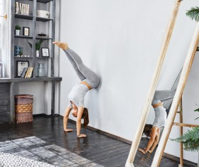 Woman practicing yoga in the living room Stock Photo 26