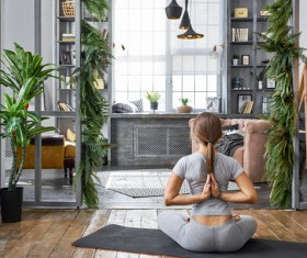 Woman practicing yoga in the living room Stock Photo 27