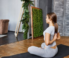 Woman practicing yoga in the living room Stock Photo 29