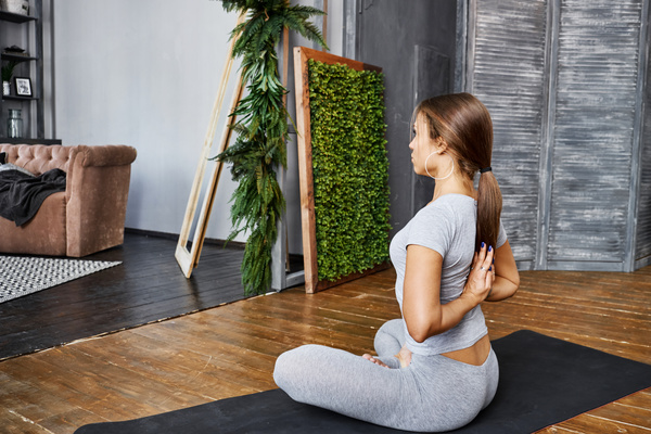 Woman practicing yoga in the living room stock photo 29 for Living room yoga sessions