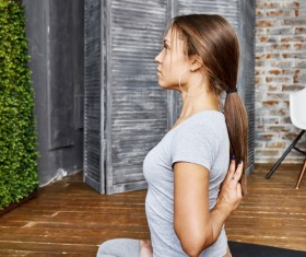 Woman practicing yoga in the living room Stock Photo 30