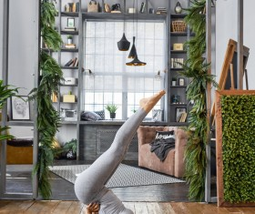 Woman practicing yoga in the living room Stock Photo 31