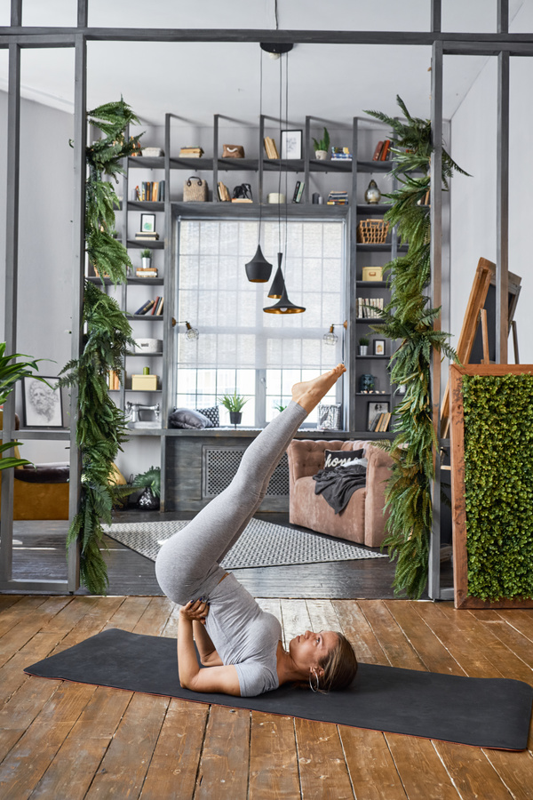 Woman practicing yoga in the living room stock photo 31 for Living room yoga