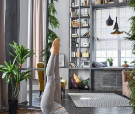 Woman practicing yoga in the living room Stock Photo 32