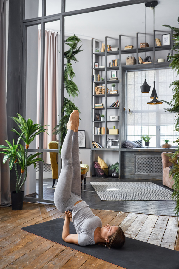 Woman practicing yoga in the living room stock photo 32 for Living room yoga sessions