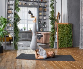 Woman practicing yoga in the living room Stock Photo 33