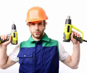 male worker with an electric drill Stock Photo