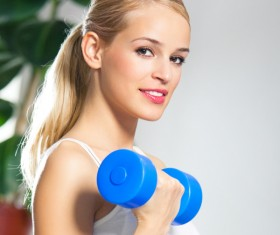 woman holding a dumbbell movement Stock Photo