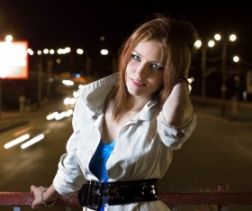 A beautiful woman on a night flyover Stock Photo