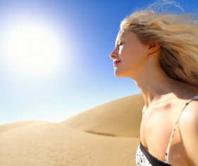 A girl with eyes closed on the sand dunes Stock Photo
