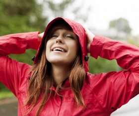 A woman in a raincoat Stock Photo