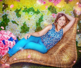 A woman lying on a rattan chair Stock Photo