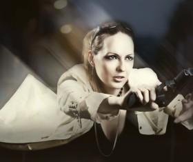 A woman with a gun Stock Photo