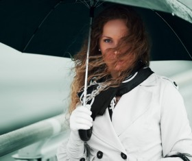 A woman with an umbrella on a rainy day Stock Photo 01