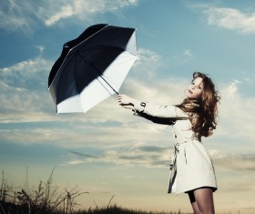 A woman with an umbrella on a rainy day Stock Photo 03