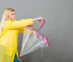 A woman with an umbrella on a rainy day Stock Photo 04