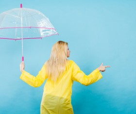 A woman with an umbrella on a rainy day Stock Photo 05