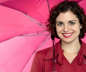 A woman with an umbrella on a rainy day Stock Photo 06