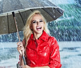 A woman with an umbrella on a rainy day Stock Photo 07
