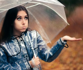 A woman with an umbrella on a rainy day Stock Photo