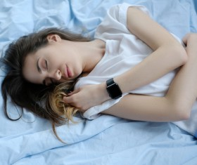 A young girl resting on the bed Stock Photo 04