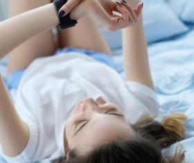 A young girl resting on the bed Stock Photo 05