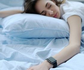 A young girl resting on the bed Stock Photo 06