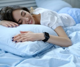 A young girl resting on the bed Stock Photo 07