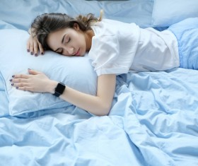 A young girl resting on the bed Stock Photo 09