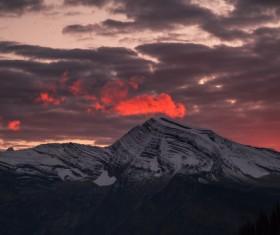 Big clouds above snowy peak Stock Photo