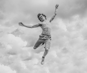 Black white picture of man jumping Stock Photo