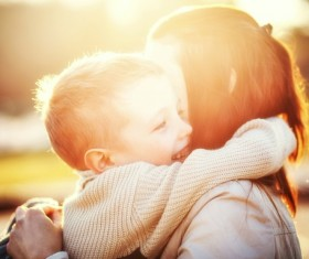 Boy hugs mother Stock Photo