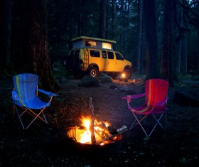 Camping bonfire and RV Stock Photo