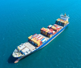 Container ship traveling at sea Stock Photo