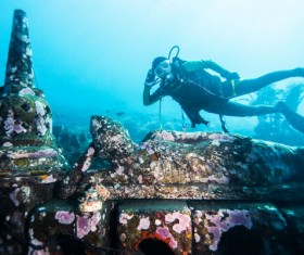 Diver with underwater artifacts Stock Photo