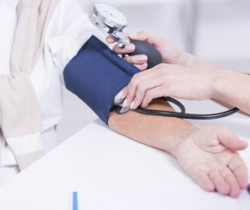Doctors check the blood pressure for the elderly Stock Photo