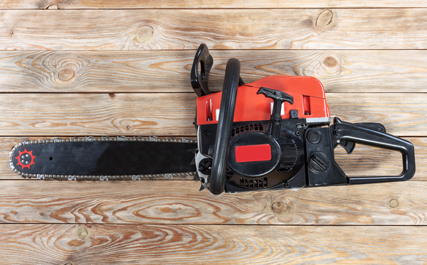 Chainsaw on wood.