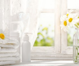 Embossed flower and towel on the windowsill Stock Photo