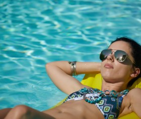 Enjoy the sunbathing woman in the pool Stock Photo 01