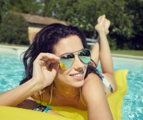 Enjoy the sunbathing woman in the pool Stock Photo 03