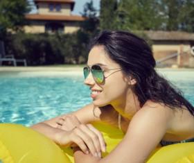 Enjoy the sunbathing woman in the pool Stock Photo 04