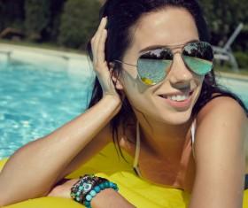 Enjoy the sunbathing woman in the pool Stock Photo 07