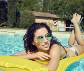 Enjoy the sunbathing woman in the pool Stock Photo 10