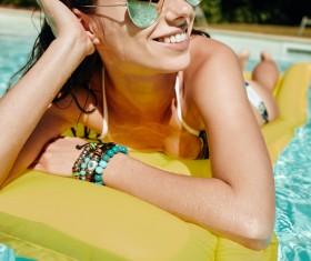 Enjoy the sunbathing woman in the pool Stock Photo 14
