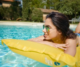 Enjoy the sunbathing woman in the pool Stock Photo 15