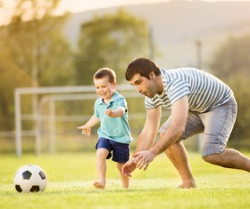 Father and son play football Stock Photo