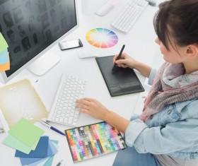 Female designers use computers Stock Photo