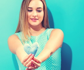 Hand holding a heart-shaped woman Stock Photo